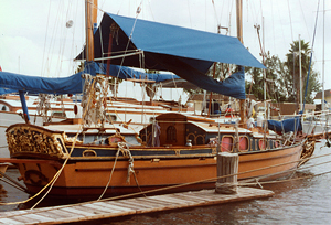 Sails down, awning up for sailboat